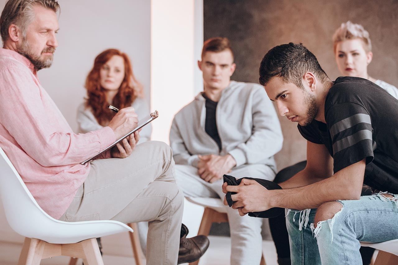 five people in a group therapy session