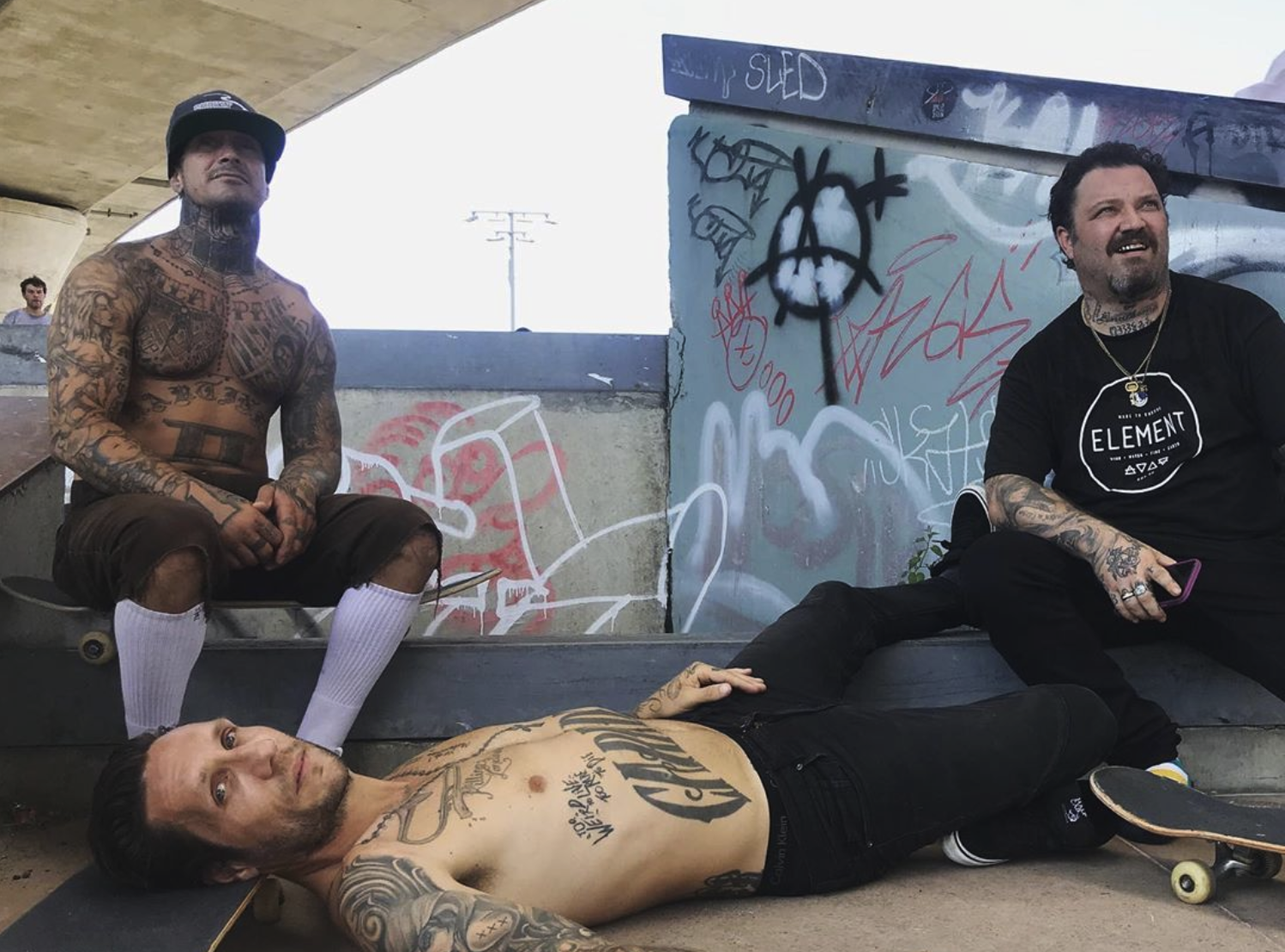 Brandon laying down on the floor at the skatepark